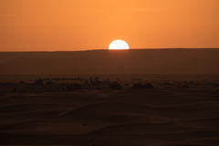 The dawn of a new day in the desert dunes of ERG in Morocco stock photography