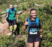 ERGAKI, RUSSIA - AUGUST 05 2017: Several athletes run through the mountains, participants trailing the SKAYRANFEST Stock Photos