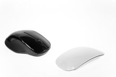 Ergonomic or Stylish Mice. Black and white mice as ergonomic or stylish royalty free stock images