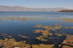 Erhai Lake in Yunnan, China fishing boat people Stock Photo