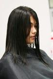 Erhalten eines Haarschnitts Stockfotografie