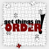 Erhalten Sie Sachen in den Bestellungs-Puzzlespiel-Stücken organisieren Ihr Leben oder arbeiten Stockbilder