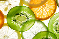 Erhellen Sie Zitrusfruchtscheiben Stockbilder