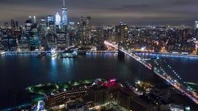 Аerial night view of Manhattan, New York City. Brooklyn bridge. Аerial timelapse dronelapse, drone. Aerial night view of Manhattan, New York City. Skyscraper stock footage