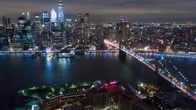 Аerial night view of Manhattan, New York City. Brooklyn bridge. Аerial timelapse dronelapse, drone. Aerial night view of Manhattan, New York City. Skyscraper stock video footage