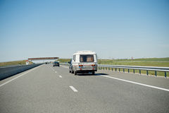 Eriba RV van and trailer driving fast to vacance Royalty Free Stock Images