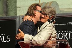 Eric Roberts, Mickey Rourke. Mickey Rourke, Eric Roberts  at a Hand and Foot Print Ceremony for Mickey Rourke, Chinese Theater, Hollywood, CA 10-31-11 Royalty Free Stock Photo