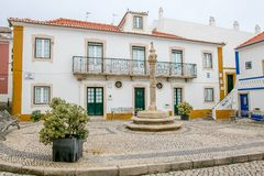 Ericeira, Portugal. Small square and a house in coastal village of Ericeira, Portugal Stock Photo