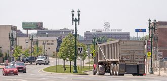 Erie Boulevard and truck and auto traffic looking south towards General Electric. Factory plant with GE logo sign atop building, downtown Schenectady New York stock images