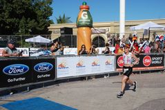 IRONMAN Los Cabos,First woman to cross finish line. Erika Csomor first woman crossing the finish line in 2013 Ironman competition royalty free stock photos