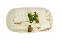 Eringii mushroom on white plate, isolated Stock Photo