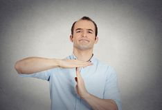 Erious confident business man showing time out gesture stock image