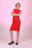 Erious girl in the red dress Royalty Free Stock Images