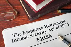 ERISA The Employee Retirement Income Security Act on a. ERISA The Employee Retirement Income Security Act of 1974  on a table Royalty Free Stock Photography