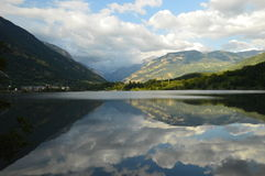 Eriste Lake one evening in August and beautiful clouds and reflections in water Royalty Free Stock Images