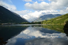 Eriste Lake one evening in August with  beautiful clouds and reflections in water Stock Images