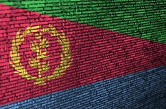 Eritrea flag is depicted on the screen with the program code. The concept of modern technology and site development.  royalty free stock photos