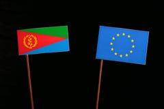 Eritrean flag with European Union EU flag isolated on black. Background Royalty Free Stock Photos