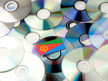 Eritrean flag on top of CD and DVD pile isolated on white Stock Image