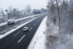 Erlangen, Germany -DECEMBER 18: German highway in winter period. Under snow with some cars, daily on December 18.2010 in Erlangen, Germany as editorial Royalty Free Stock Images
