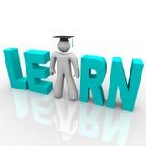 Erlernen Sie - Mann im Wort mit Staffelung-Schutzkappe Lizenzfreies Stockfoto
