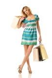 Ermüdetes Einkaufenmädchen Stockbild
