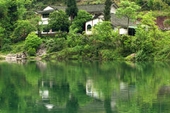 Ermei mountain's scenery. A house near by the lake in mountain Stock Images