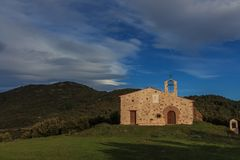 Ermita Sant Elies.The colors of Autumn appear on the mountain, corollarizing it. The colors of Autumn appear on the mountain, corollarizing it Stock Image