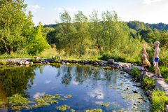 Ermolino, Russia - August 2018: A pond with a bath at the Church of St. Nicholas in Rusinovo stock photos