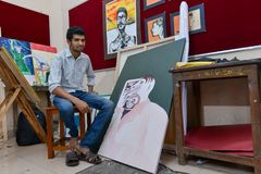 Student at workshop of Art College in India. Ernakulam, India - January 19, 2016: RLV College of Music and fine arts. Male student sitting in an artist workshop Stock Photography