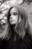 Ernest little girl. With beautiful hair Royalty Free Stock Photo