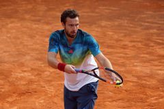 Ernests Gulbis (LAT). ROME, ITALY - MAY 9, 2016: Ernests Gulbis (LAT) during his 1st round at the Internazionali BNL d'Italia in Rome, Italy against Ivo Karlovic Royalty Free Stock Photography
