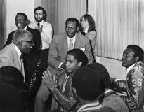 Ernie Banks. Hall of Fame Major League baseball player, Ernie Banks, is joined by an elderly jazz musician high school officials and students at an inter Royalty Free Stock Image