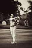 Ernie Els. On the fairway, swinging away. Watching the ball as it leaves his club Royalty Free Stock Image