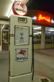 Ernie's Old Mobil Gas Station. And Pumps at night in Santa Paula, California stock photo
