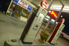 Ernie's Old Mobil Gas Station. And Pumps at night in Santa Paula, California Royalty Free Stock Image