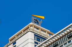 Ernst and Young sign on modern building facade. Milan, Italy - April 19th, 2018: Ernst and Young sign on modern building facade Stock Photography