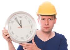 Ernste Bauzeit (spinnende Uhrzeigerversion) lizenzfreies stockbild
