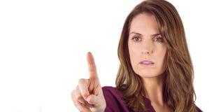 Ernste Frau, die ihren Finger auf Kamera zeigt Lizenzfreies Stockbild