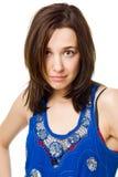 Ernste junge Frau getrennt auf weißem Hintergrund Stockbilder