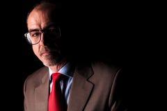 Ernste reife tragende Gläser des Geschäftsmannes Stockfotografie