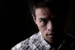 Ernster asiatischer Mann Stockfotografie