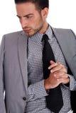 Ernster Geschäftsmann mit seiner halben weared Klage Stockfotografie