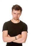 Ernster junger Mann mit dem hellen Bart, lokalisiert auf Weiß Stockfoto