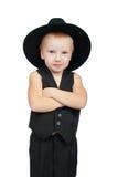 Ernster kleiner Junge in einer Weste Lizenzfreies Stockfoto