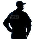 Ernster Polizist mit dem Schauen zu seiner Seite Stockbild