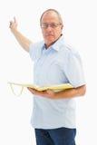 Ernster Predigermann, der Evangelium zeigt und hält Stockbilder
