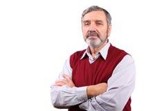 Ernster Standplatz des älteren Mannes in der Wolljacke Lizenzfreie Stockbilder
