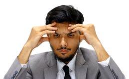 Ernstes Gesicht des jungen Geschäftsmannes auf weißem Hintergrund Stockbild