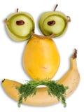 Ernstes Gesicht gebildet von den Früchten lizenzfreies stockfoto